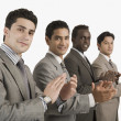 Four businessmen applauding — Stock Photo #33039545
