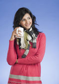 Woman holding a cup of coffee — Stock Photo