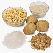 Raw potatoes with cereals — Stock Photo