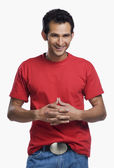 Man standing with his hands clasped — Stock Photo