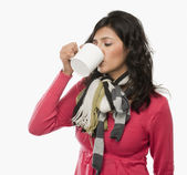 Woman drinking a cup of coffee — Stock Photo
