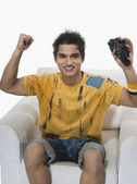 Man cheering while playing video game — Stock Photo