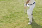 Cricket batsman playing a defensive stroke — Stock Photo