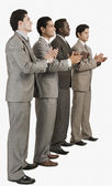 Four businessmen applauding — Stockfoto