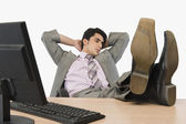 Businessman relaxing in an office — Stock Photo