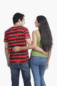 Couple standing with arm around — Stock Photo