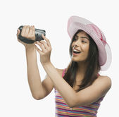 Woman filming herself with a home video camera — Stock Photo