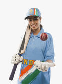 Female cricketer tossing a cricket ball — Stock Photo