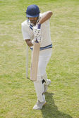 Batsman in backward defense stance — Stockfoto