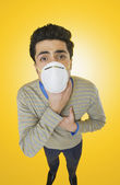 Businessman wearing pollution mask — Stock Photo