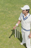 Cricket player near wicket — Stock Photo