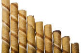 Chocolate wafer sticks in a row — Stock Photo
