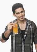 Man holding a glass of juice — Stock Photo