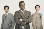 Three businessmen standing together — Stock Photo