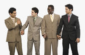 Businessmen standing with holding hands — Stock Photo