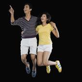 Couple jumping — Stock Photo