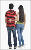 Rear view of a couple standing with arm around — Stock Photo
