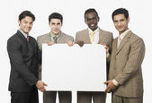 Businessmen showing a blank placard — Stock Photo
