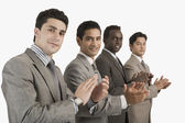 Four businessmen applauding — Stock Photo