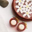 Candles with Frangipani flowers in a bowl — Stock Photo