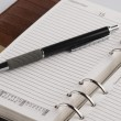 Pen on a personal organizer — Stock Photo