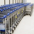 Row of luggage carts in airport — Stock Photo