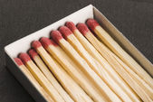 Open matchbox with matchsticks — Stock Photo
