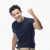 Man making fist and smiling — Stock Photo