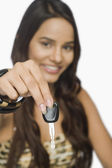 Woman showing a car key — Stock Photo