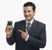 Businessman showing a mobile phone — Foto Stock