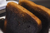 Burnt toasts in a toaster — Foto de Stock