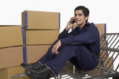 Store manager talking on a mobile phone — Stock Photo