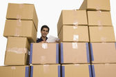 Store manager with cardboard boxes — Stock Photo