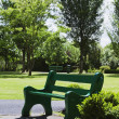 Stock Photo: Empty bench in park
