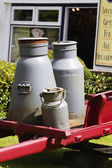 Milk canisters in front of a store — Stock Photo