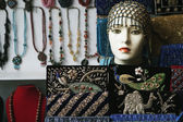Showpieces with necklaces at a market stall — Stock Photo