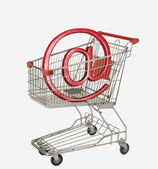 Internet symbol in a shopping cart — Stok fotoğraf