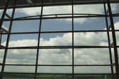 Clouds viewed through an airport lounge window — Stock Photo