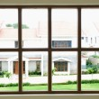 Stock Photo: Bungalow viewed from window