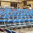 Rows of chairs in courtyard — Stock Photo