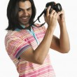 Photographer taking a picture with a digital camera — Stock Photo