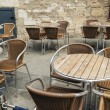 Tables and chairs at an outdoor cafe — Stock Photo