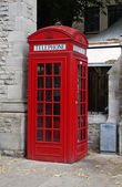 Telephone booth on a street — Stock Photo