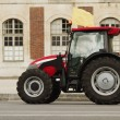 Tractor in front of a building — Stock Photo