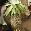 Pineapple hanging at a stall — Foto Stock