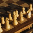 Chess pieces arranged on a chess board — Foto Stock