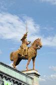 Equestrian statue at a church — Stock Photo