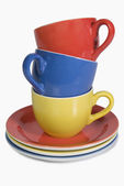 Stack of colorful tea cups with saucers — Stock Photo