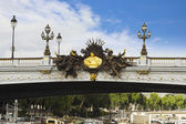 Lampposts on a bridge, Pont Alexandre III — Stock Photo