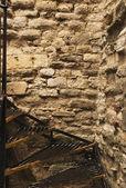 Staircase along a stone wall — Stock Photo
